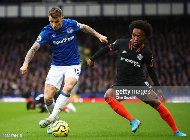 Lucas Digne of Everton battles for possession with Willian of Chelsea during the Premier League match between Everton FC and Chelsea FC at Goodison...