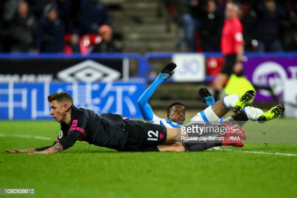 Lucas Digne of Everton brings down Adama Diakhaby of Huddersfield Town which results in a red card during the Premier League match between...