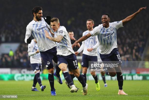 Lucas Digne of Everton celebrates after scoring his team's second goal with Yerry Mina and Andre Gomes during the Premier League match between...