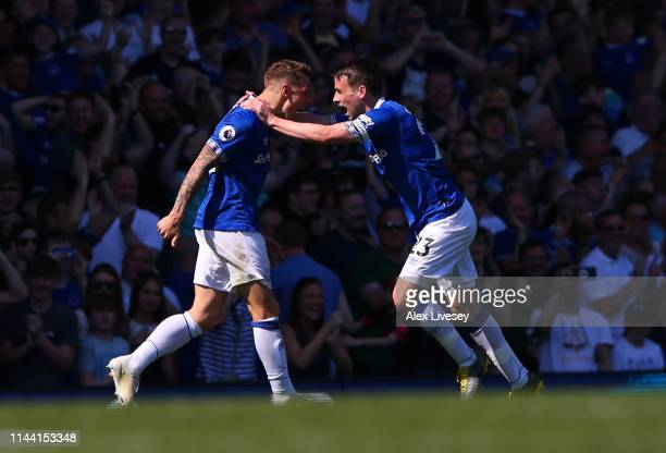 Lucas Digne of Everton celebrates with teammate Seamus Coleman after scoring his team's third goal during the Premier League match between Everton FC...