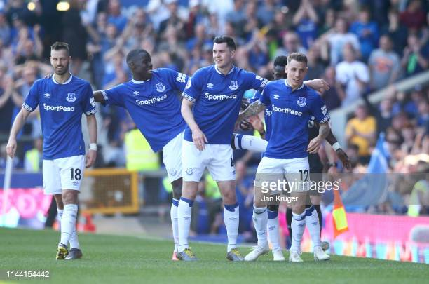 Lucas Digne of Everton celebrates with teammates after scoring his team's third goal during the Premier League match between Everton FC and...