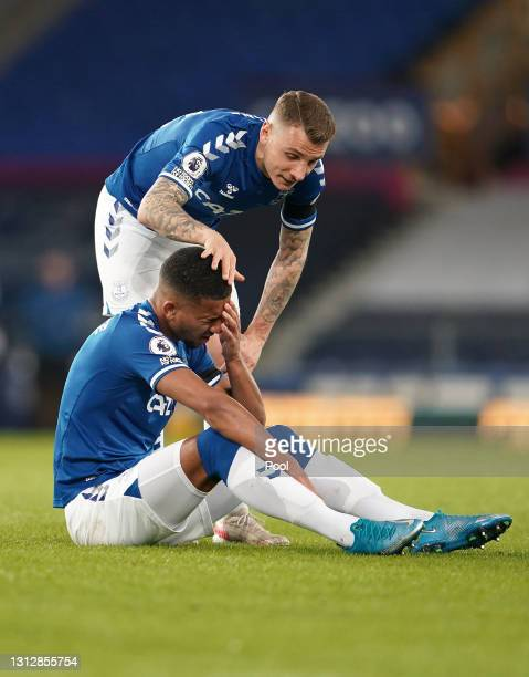 Lucas Digne of Everton checks on Mason Holgate of Everton during the Premier League match between Everton and Tottenham Hotspur at Goodison Park on...