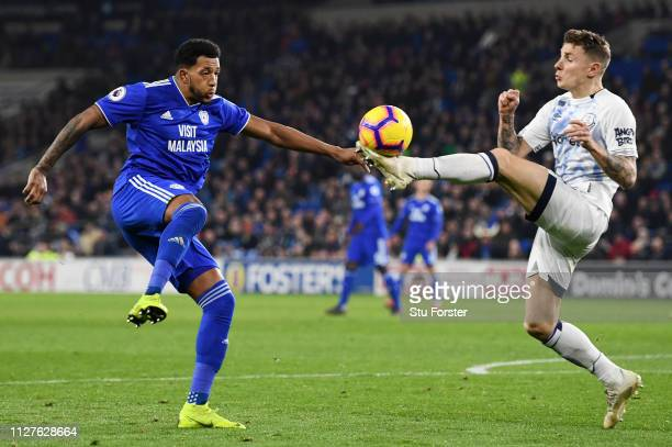 Lucas Digne of Everton clears from Nathaniel MendezLaing of Cardiff City during the Premier League match between Cardiff City and Everton FC at...
