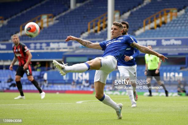 Lucas Digne of Everton clears the ball during the Premier League match between Everton FC and AFC Bournemouth at Goodison Park on July 26 2020 in...