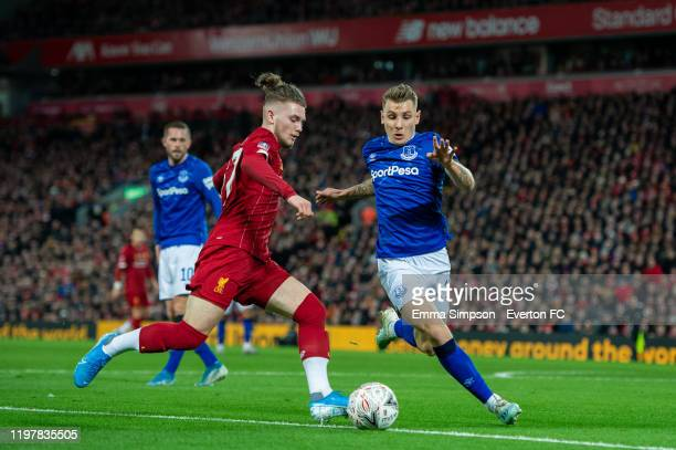 Lucas Digne of Everton defends as Harvey Elliott of Liverpool prepares to take a cross during the FA Cup Third Round match between Liverpool and...