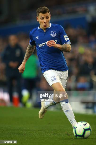Lucas Digne of Everton FC runs with the ball during the Premier League match between Everton FC and Chelsea FC at Goodison Park on March 17 2019 in...