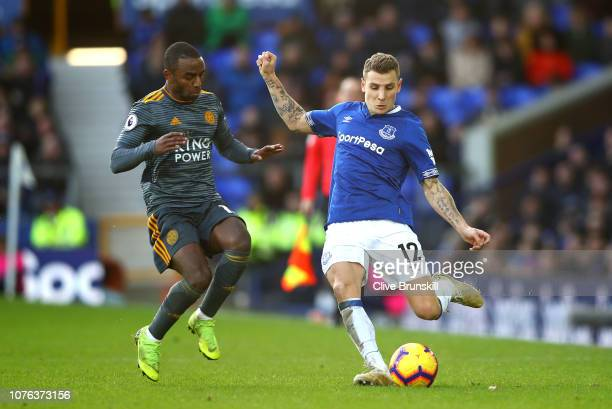 Lucas Digne of Everton is closed down by Ricardo Pereira of Leicester City during the Premier League match between Everton FC and Leicester City at...