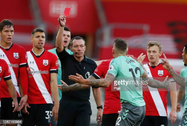 Lucas Digne of Everton is shown a red card by referee Kevin Friend after fouling Kyle Walker-Peters of Southampton during the Premier League match...
