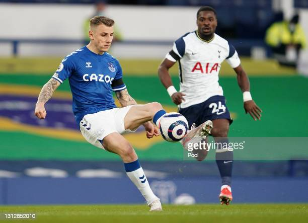 Lucas Digne of Everton makes a pass whilst under pressure from Serge Aurier of Tottenham Hotspur during the Premier League match between Everton and...