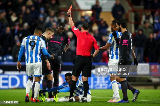 Lucas Digne of Everton receives a red card during the Premier League match between Huddersfield Town and Everton FC at John Smith's Stadium on...