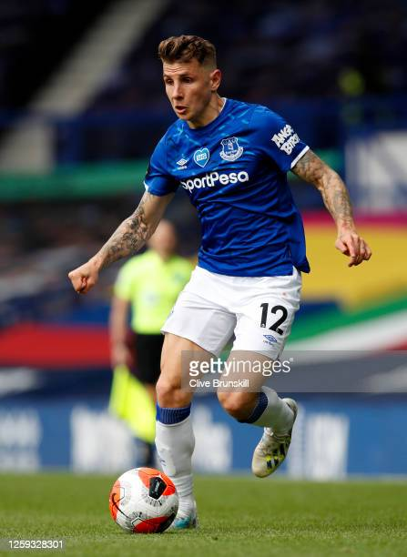 Lucas Digne of Everton runs with the ball during the Premier League match between Everton FC and AFC Bournemouth at Goodison Park on July 26 2020 in...