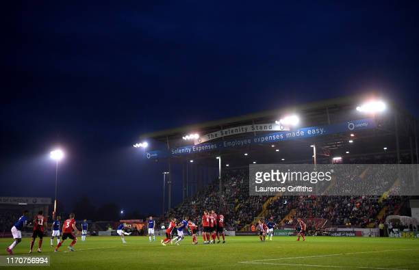 Lucas Digne of Everton scores his team's first goal during the Carabao Cup Second Round match between Lincoln City and Everton at Sincil Bank Stadium...