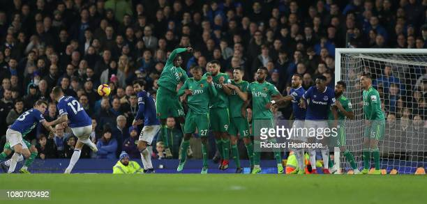 Lucas Digne of Everton scores the equalising goal from a free kick in injury time during the Premier League match between Everton FC and Watford FC...
