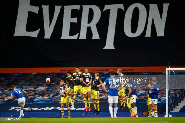 Lucas Digne of Everton takes a freekick during the Premier League match between Everton FC and Southampton FC at Goodison Park on July 09 2020 in...