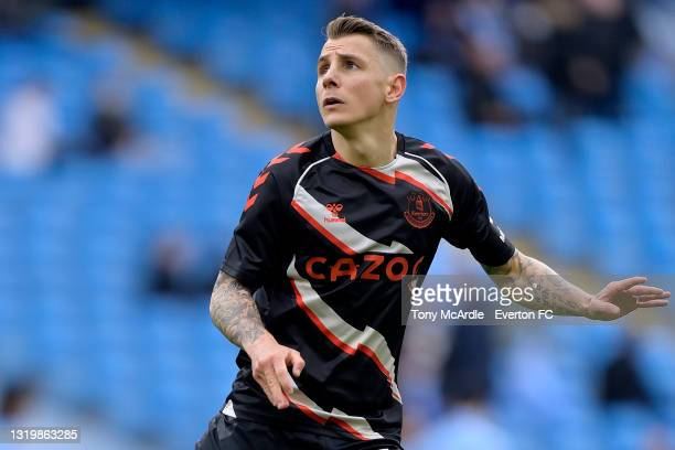 Lucas Digne of Everton warms up before the Premier League match between Manchester City and Everton at the Etihad Stadium on May 23, 2021 in...
