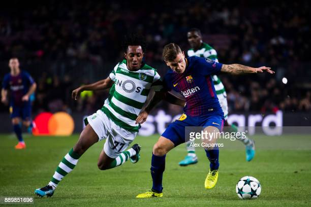 Lucas Digne of FC Barcelona competes for the ball with Gelson Martins of Sporting CP during the UEFA Champions League group D match between FC...