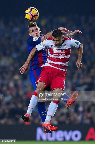 Lucas Digne of FC Barcelona fighting for the ball with Isaac Cuenca of Granada CF during the Spanish League match between FC Barcelona vs Granada CF...