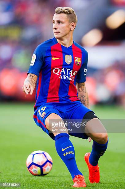 Lucas Digne of FC Barcelona runs with the ball during the La Liga match between FC Barcelona and Real Betis Balompie at Camp Nou on August 20 2016 in...