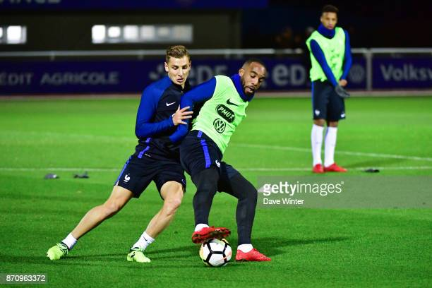 Lucas Digne of France and Alexandre Lacazette of France challenge for the ball as Corentin Tolisso of France looks on during the training session at...