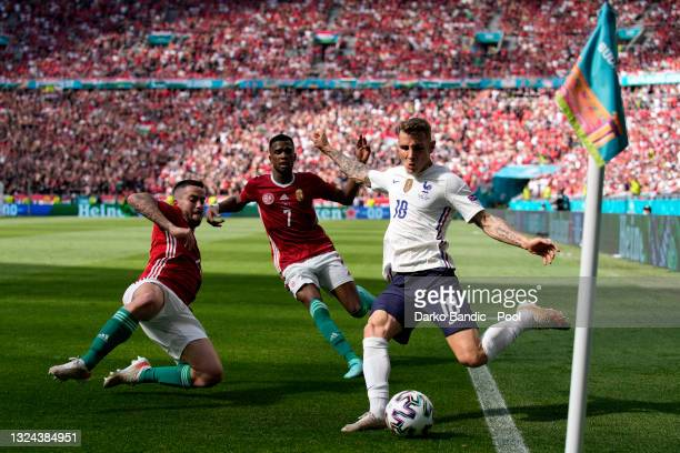 Lucas Digne of France attempts a cross whilst under pressure from Endre Botka and Loic Nego of Hungary during the UEFA Euro 2020 Championship Group F...