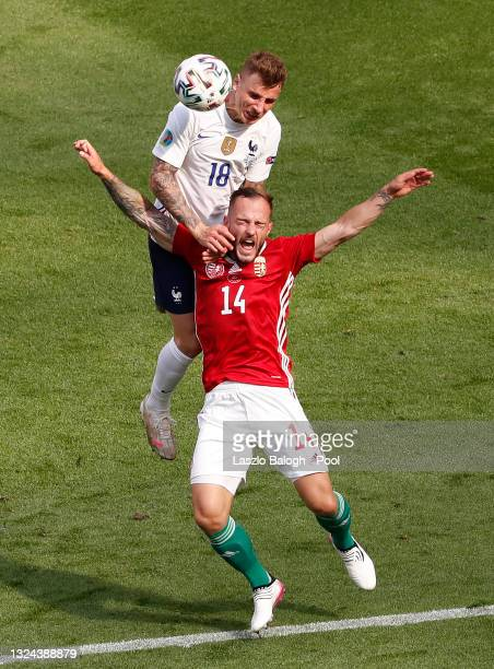 Lucas Digne of France competes for a header with Gergo Lovrencsics of Hungary during the UEFA Euro 2020 Championship Group F match between Hungary...