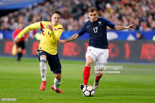 Lucas Digne of France controls the ball against Santiago Arias of Colombia during the international friendly match between France and Colombia at...
