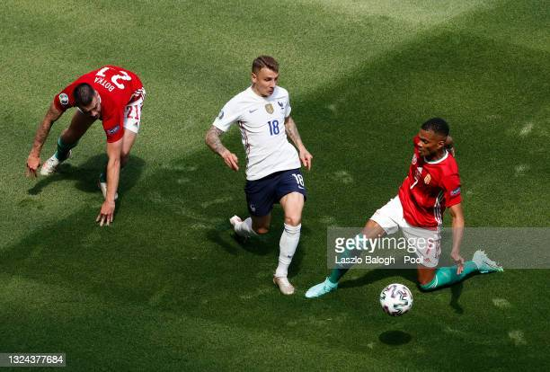 Lucas Digne of France is challenged by Loic Nego of Hungary during the UEFA Euro 2020 Championship Group F match between Hungary and France at Puskas...