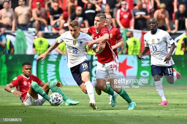 Lucas Digne of France is closed down by Roland Sallai of Hungary during the UEFA Euro 2020 Championship Group F match between Hungary and France at...