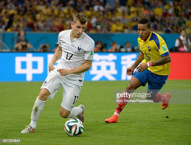 Lucas Digne of France with Michael Arroyo of Ecuador during the 2014 FIFA World Cup Brazil Group E match between Ecuador and France at Maracana on...