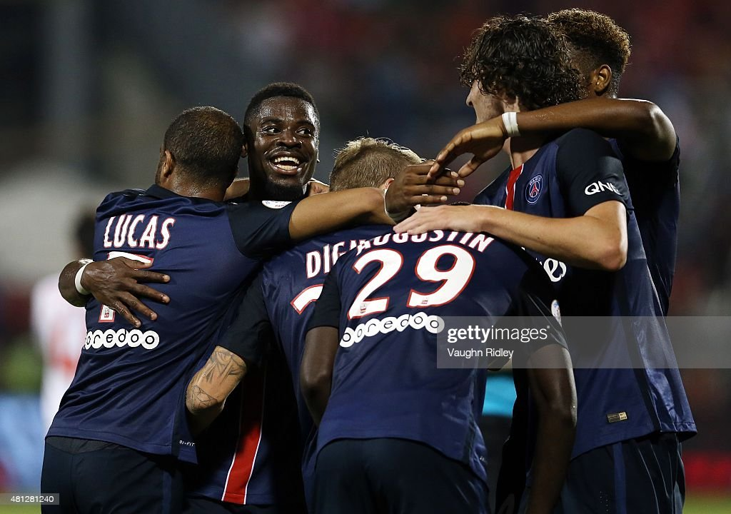 Lucas Digne #21 of Paris Saint-Germain celebrates with teammates after scoring a goal during the 2015 International Champions Cup match against Benfica at BMO Field on July 18, 2015 in Toronto, Ontario, Canada.