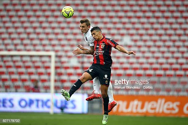 Lucas Digne of Paris SG jumps to win a header with Said Benrahma of OGC Nice during the French championship L1 football match between OGC Nice and...