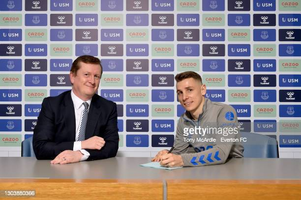 Lucas Digne poses for a photograph with club secretary David Harrison after signing a new contract with Everton at USM Finch Farm on February 24 2021...