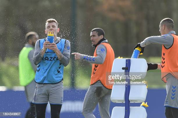 Lucas Digne splashes water on his face during the Everton Training Session at USM Finch Farm on February 25 2021 in Halewood, England.
