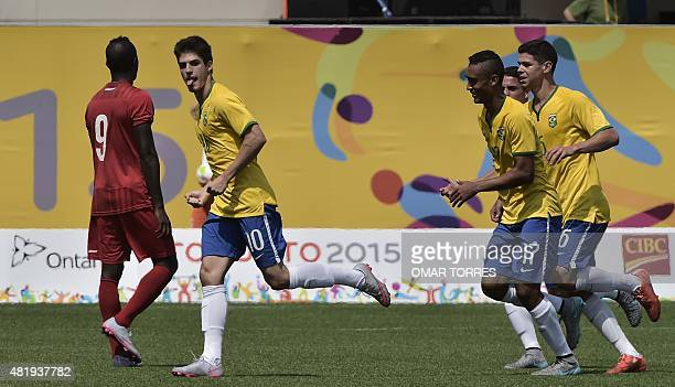 Lucas Domingues of Brazil celebrates after scoring the team's second goal against Panama during the bronze medal football match of the Pan American...