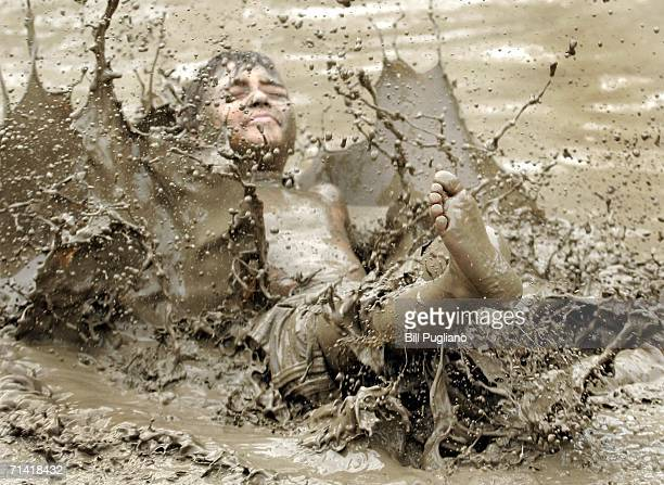 Lucas D'orazio of Westland Michigan dives into the mud at Wayne County's annual Mud Day event July 11 2006 in Westland Michigan The event consists of...