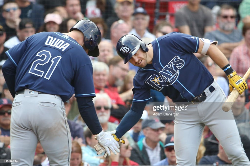 Lucas Duda #21 high fives Evan Longoria #3 of the Tampa Bay Rays after hitting a solo home run in the seventh inning of a game against the Boston Red Sox at Fenway Park on September 10, 2017 in Boston, Massachusetts.