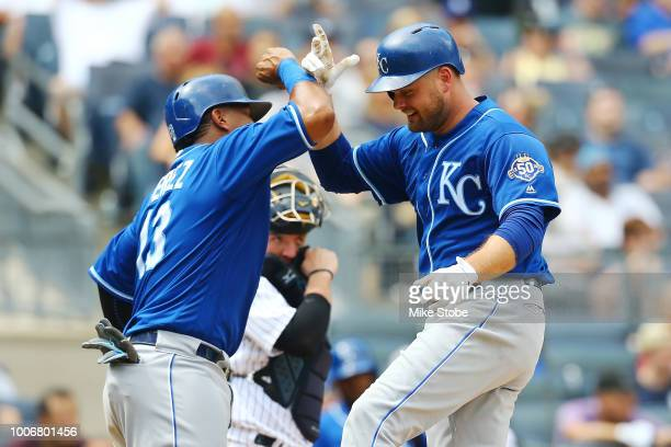 Lucas Duda of the Kansas City Royals celebrates with Salvador Perez after hitting a 2run home run in the fifth inning against the New York Yankees at...