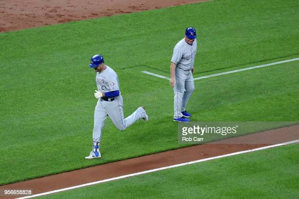 Lucas Duda of the Kansas City Royals celebrates with third base coach Mike Jirschele during the fourth inning against the Baltimore Orioles at Oriole...
