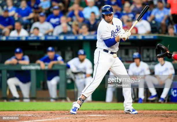 Lucas Duda of the Kansas City Royals is hit by a pitch with bases loaded during the fifth inning against the Boston Red Sox at Kauffman Stadium on...