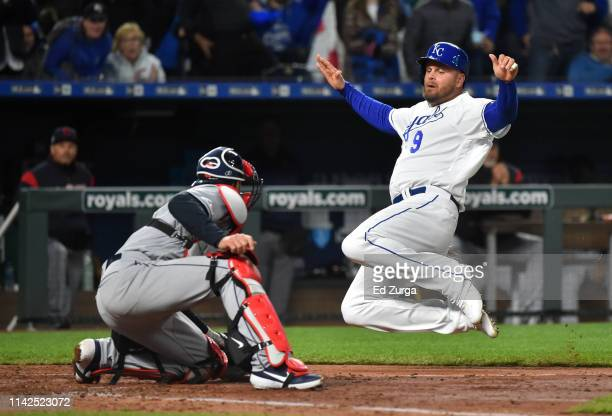 Lucas Duda of the Kansas City Royals slides into home as he tries to score against Kevin Plawecki of the Cleveland Indians in the seventh inning at...