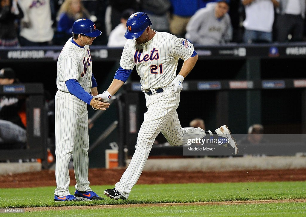 Lucas Duda #21 of the New York Mets celebrates a home run with third base coach Tim Teufel #18 during the third inning of game two of a doubleheader against the Miami Marlins on September 14, 2013 at Citi Field in the Flushing neighborhood of the Queens borough of New York City.