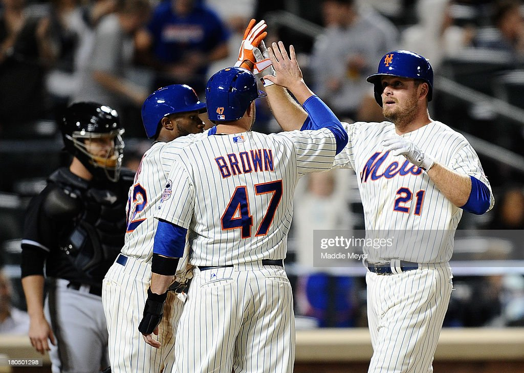 Lucas Duda #21 of the New York Mets celebrates a three-run homer with teammates Andrew Brown #47 and Eric Young Jr. #22 during the sixth inning against Miami Marlins at Citi Field on September 13, 2013 in New York City.