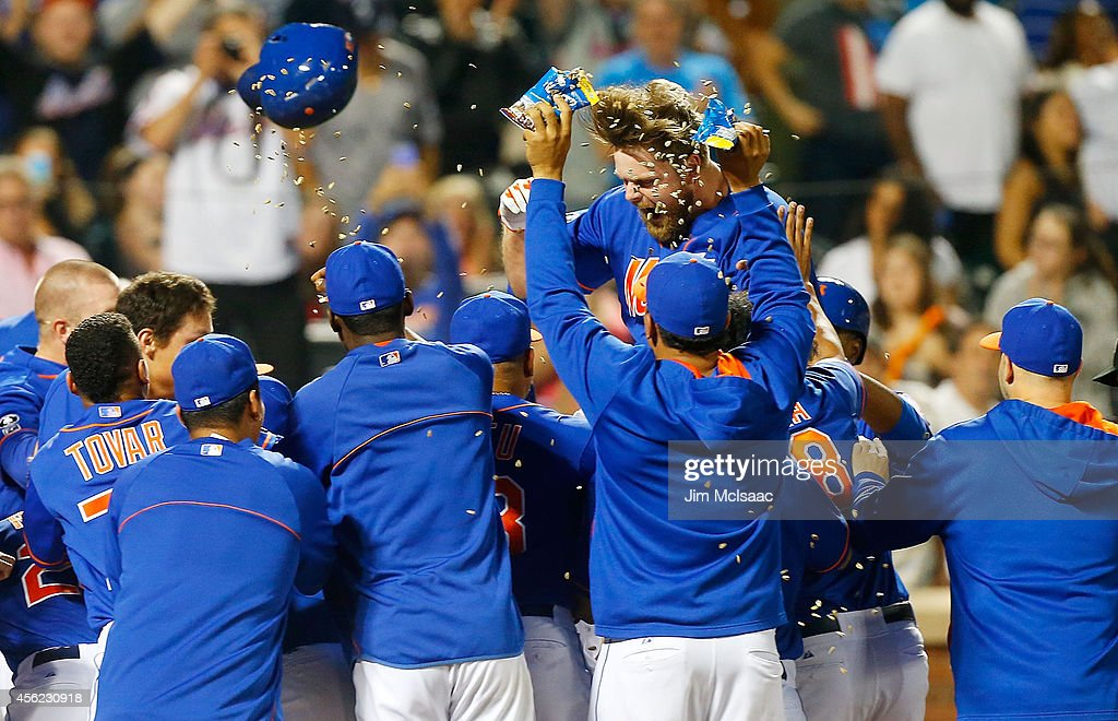 Lucas Duda #21 of the New York Mets celebrates his ninth inning game winning two run home run against the Houston Astros with his teammates at Citi Field on September 27, 2014 in the Flushing neighborhood of the Queens borough of New York City.