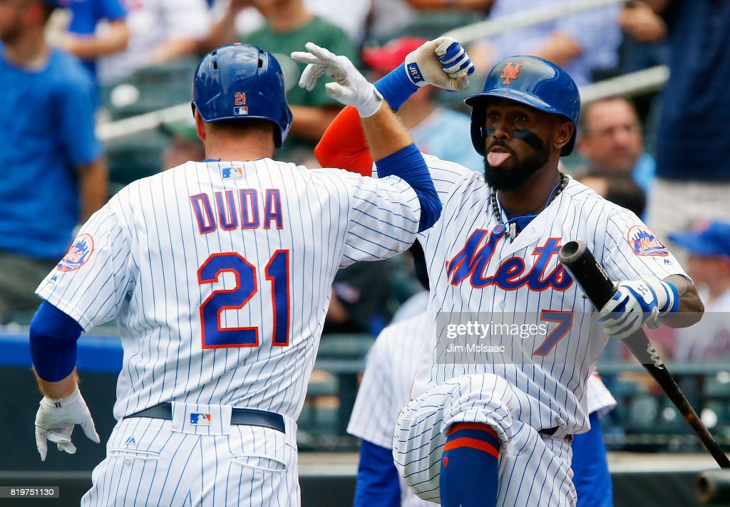 Lucas Duda #21 of the New York Mets celebrates his second inning home run against the St. Louis Cardinals with teammate Jose Reyes #7 on July 20, 2017 at Citi Field in the Flushing neighborhood of the Queens borough of New York City.