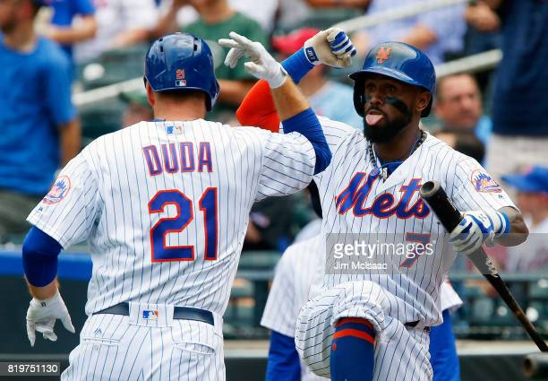 Lucas Duda of the New York Mets celebrates his second inning home run against the St Louis Cardinals with teammate Jose Reyes on July 20 2017 at Citi...