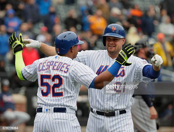 Lucas Duda of the New York Mets celebrates his two run home run in the third inning with Yoenis Cespedes against the Atlanta Braves during their game...