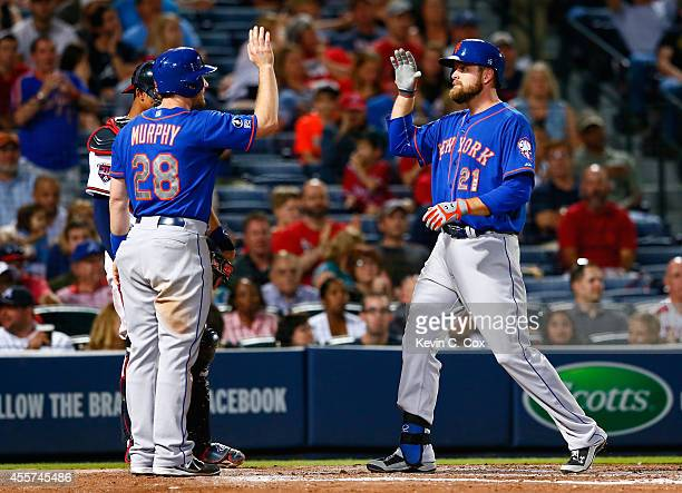 Lucas Duda of the New York Mets celebrates his tworun homer in the sixth inning against the Atlanta Braves that scored Daniel Murphy at Turner Field...