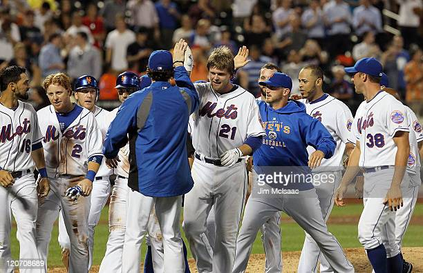 Lucas Duda of the New York Mets celebrates his walk off two-run ninth inning single against the San Diego Padres with his teammates at Citi Field on...