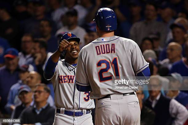Lucas Duda of the New York Mets celebrates with Curtis Granderson after hitting a three run home run in the first inning against Jason Hammel of the...