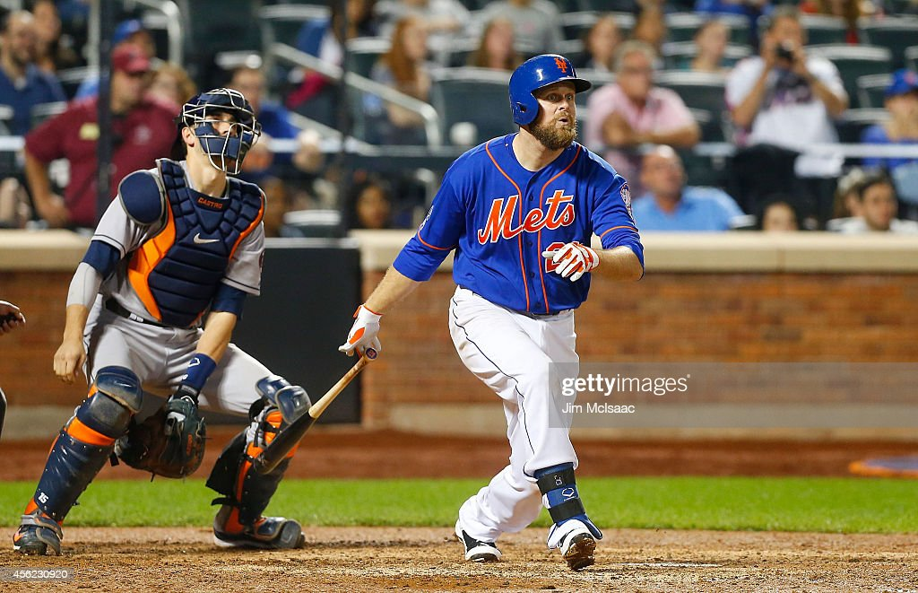 Lucas Duda #21 of the New York Mets follows through on his ninth inning game winning two run home run against the Houston Astros at Citi Field on September 27, 2014 in the Flushing neighborhood of the Queens borough of New York City.